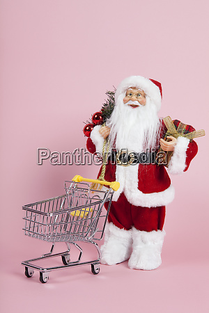 santa claus pink background shopping trolley