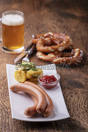 closeup of frankfurter sausages on rustic