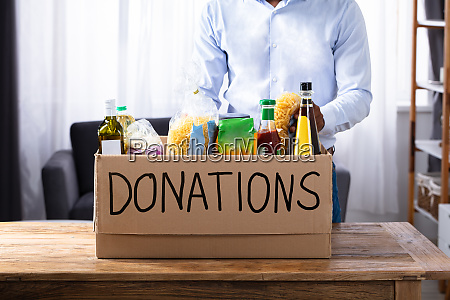 man with donation box