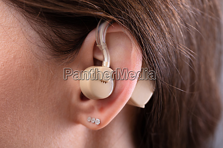 womans ear with hearing aid