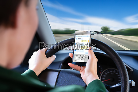 woman, checking, text, messages, on, smartphone - 26052549