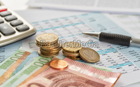 euro bills and euro coins on