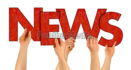 news people holding up red wooden