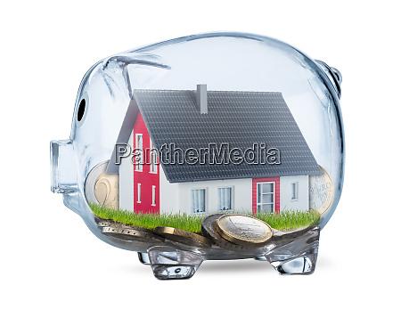 transparent piggy bank real estate concept