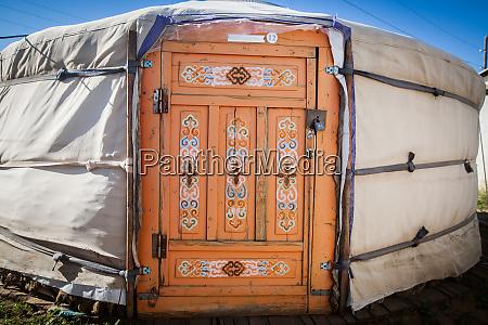 wooden door of a yurt in