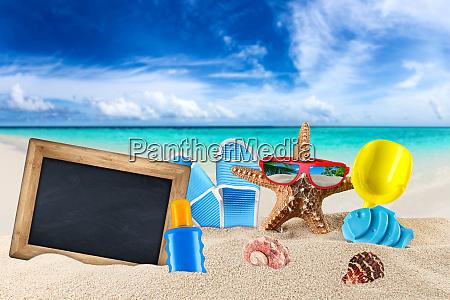 empty blackboard and beach supplies accessory