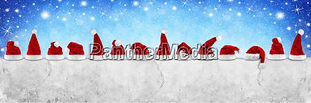row of red white santa claus