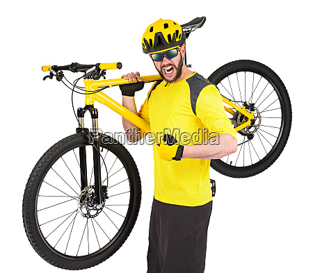 young cyclist with yellow mountain bike
