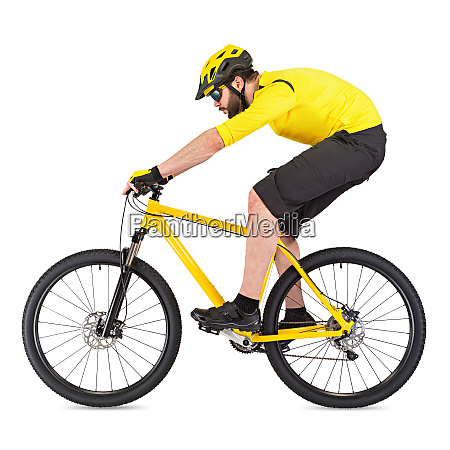 young cyclist on yellow mountain bike