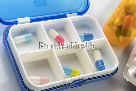 pillbox with several capsules daily medication