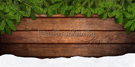 fir branches frame on wood