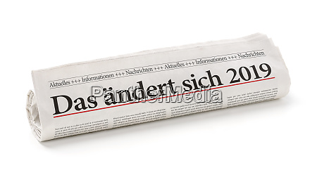 rolled newspaper with the german headline
