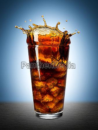 cola glass ice splash