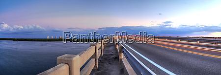 light trails along bridge along estero