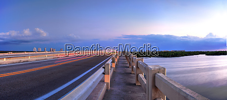 light trails along bridge along estero