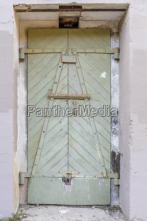 ruins of a metal door at