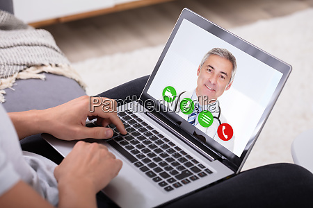 man video conferencing with doctor on