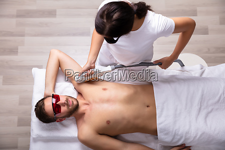 young man having underarm laser hair