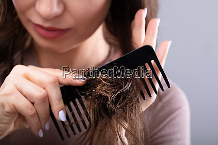 close up of a woman combing