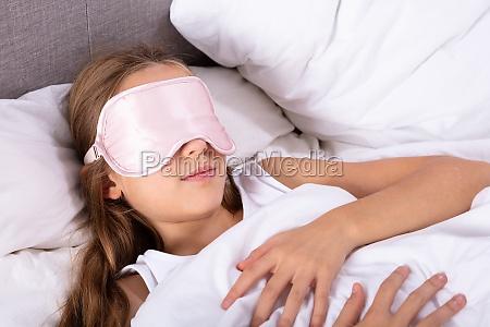 girl sleeping with eye mask