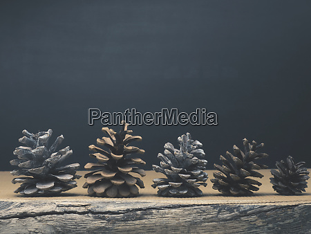 pine cones on a rustic wooden