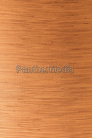 tan textured bamboo fabric background