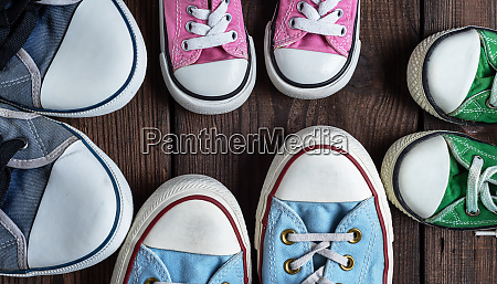 four pairs of old textile sneakers