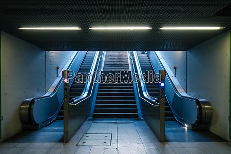 escalator subway station nobody blue daylight