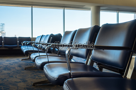 airport chairs empty gate terminal row