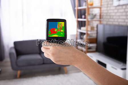 woman using infrared thermal camera in