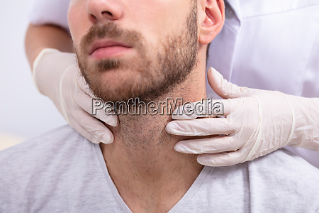 doctor performing physical exam palpation of