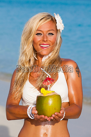 blonde girl with coconut in her