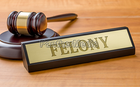 a gavel and a name plate