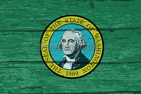 washington state flag on old timber