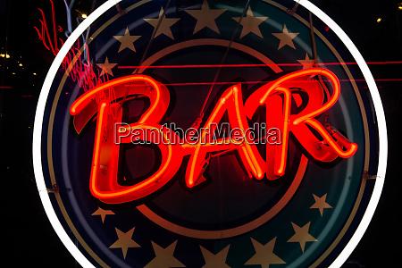 neon bar sign expressive stars circle