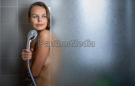 woman taking a long hot shower