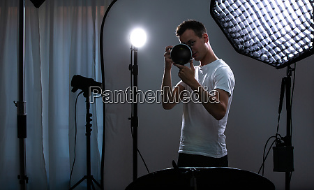 young pro photographer with digital camera