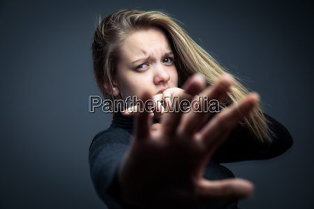 young woman being a domestic violence