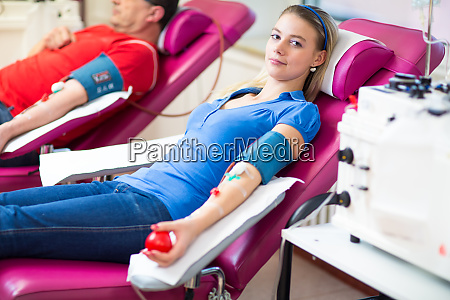 young woman giving blood in a