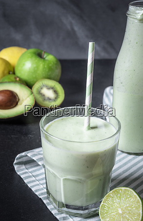 healthy green smoothie in a glass
