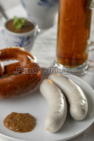 bavarian white sausages with pretzel