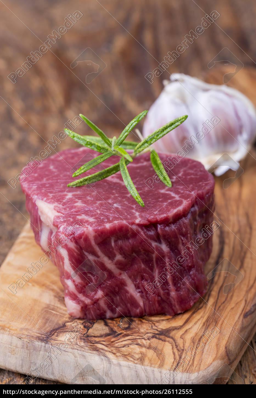 raw, steak, on, dark, wood - 26112555
