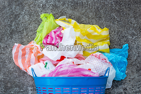 colorful plastic bags with trash basket