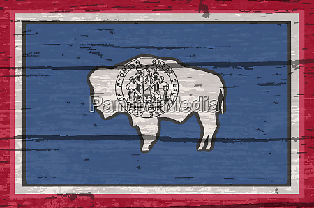 wyoming state flag on old timber