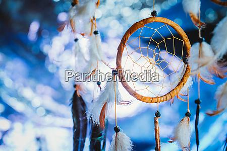 dreamcatcher against a white blur of