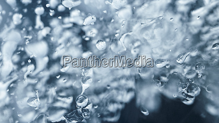 water drops on frozen ice background