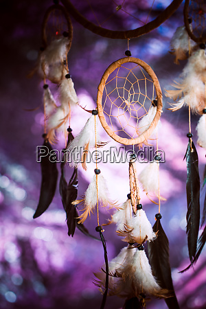 dreamcatcher against a background of purple