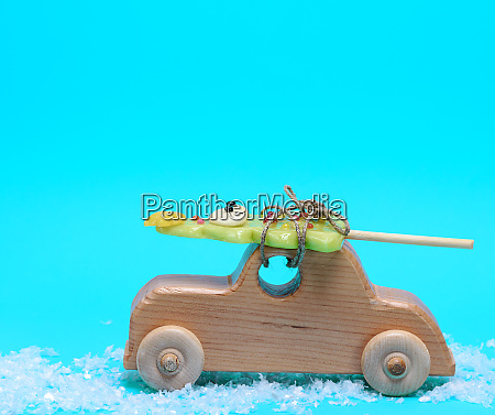 wooden childrens car on a blue