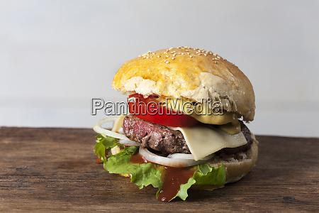 home made hamburger on rustic wood