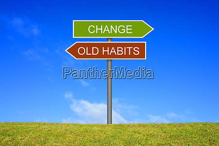signpost showing old habits and change